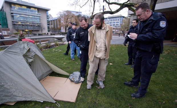 Police arrest David Arthur Johnston in this file photo from 2009 for violating court-ordered conditions by erecting a tent in Centennial Square during the day. Ci