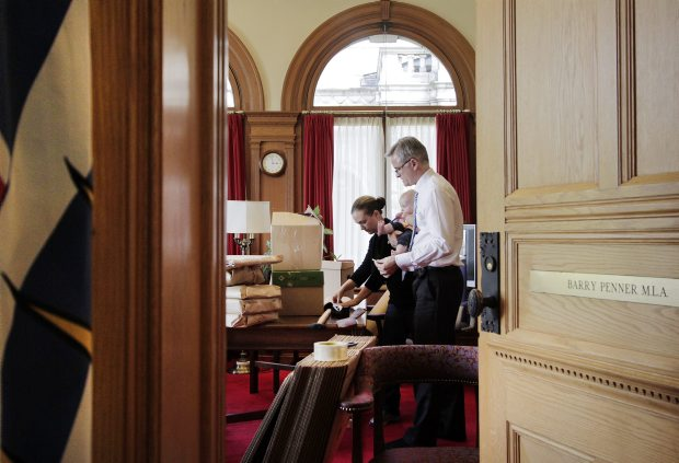 In this file photo from August, 2011, then Attorney General Barry Penner, with his wife Daris LaPointe and six-month-old daughter Fintry, packs up his legislature office after announcing his resignation from the job.