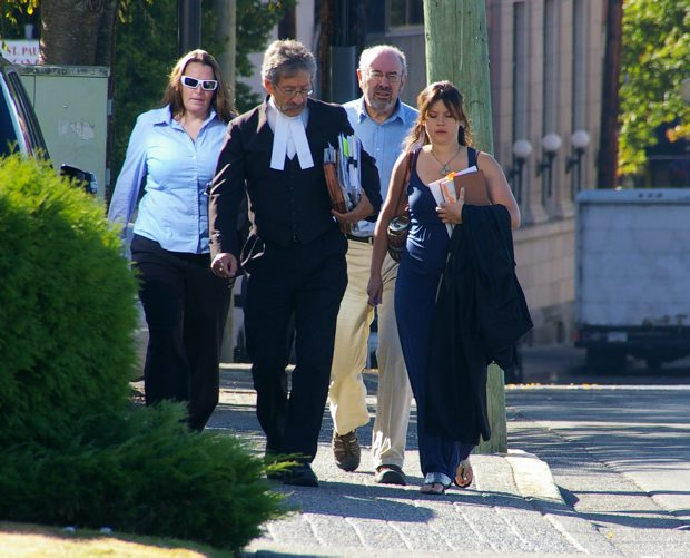 Clare Bekkers, left, flanked by her lawyer Bert King (and his assistant, far right) and her father, John Harrison, walk to the Nanaimo courthouse in a file photo from September.