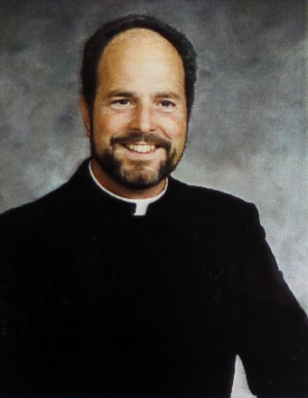 Father Philip Jacobs is charged with one count of sexual assault, two counts of sexual interference and one count of sexual exploitation.