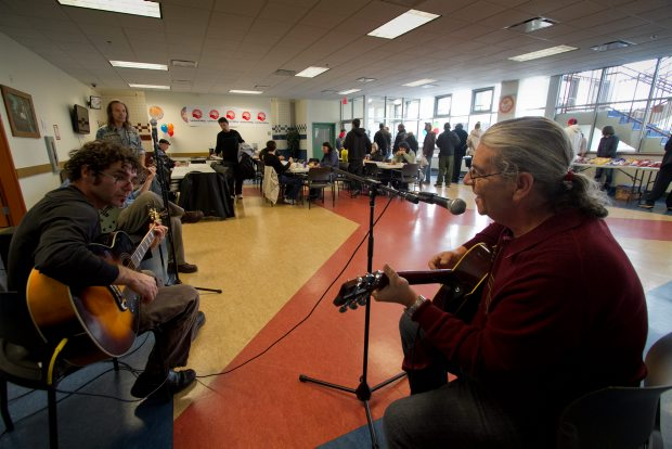 Volunteer James Luker entertains at a lunch to celebrate the first year of the Rock Bay Landing facility.