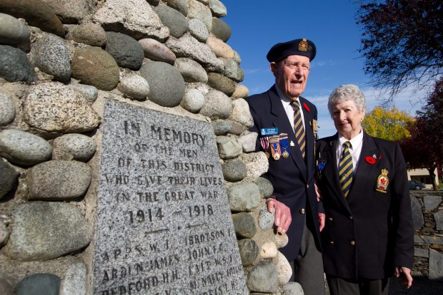Veteran Jack Pedlow, 93, and Val Noyes, Saanich legion branch president, visit the cenotaph in Sidney.