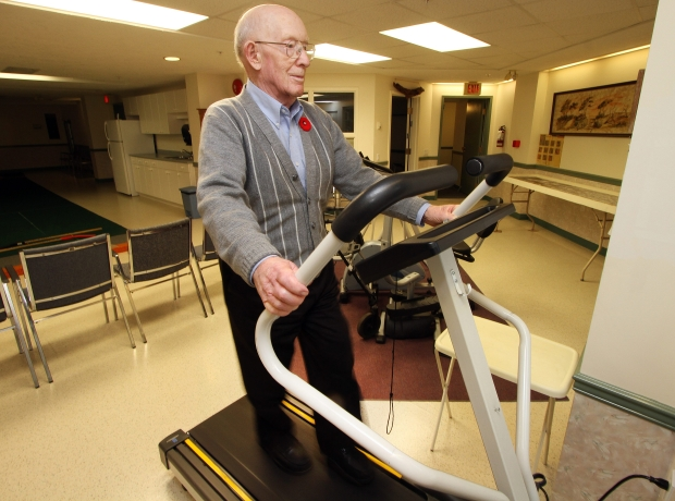 Hugh Miller exercises on a treadmill at his home in Saanich on Nov. 8, 2011