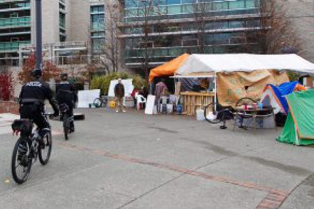 Police ride through the Occupy Victoria protest site in Centennial Square last week.