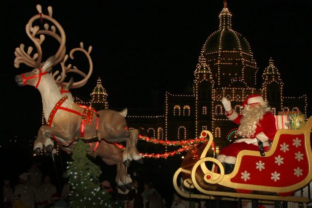 In this file photo from 2009, Santa Claus and his reindeer pass the legislature during the Island Farms Santa's Light Parade.