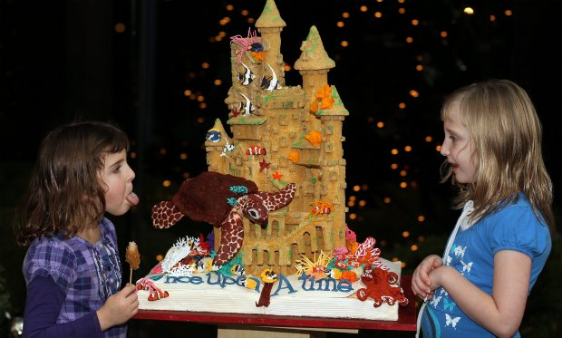 "Kaityln McKellar, left, and sister Kendalyn discuss the castle  ""Poseidon's Playground"" sponsored by Melanie Lonsdale. The gingerbread house is on display at The Inn at Laurel Point as the hotel presents its third annual Great Gingerbread Showcase, which is also a fundraiser for Habitat for Humanity Victoria"