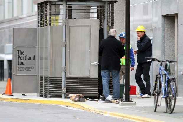 City of Victoria workers install a new $90,000 unisex toilet on Langley Street, near the Maritime Museum of B.C. at Bastion Square on Tuesday Nov. 29, 2011. Unlike the city's first freestanding urinal, the new loo has a door and it has louvres at the bottom so you can see it's occupied.