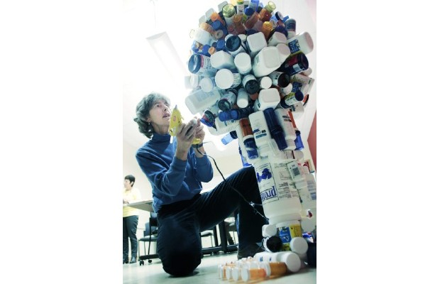 Peggy Frank with the tower of pill bottles that she used during her treatment for HIV.