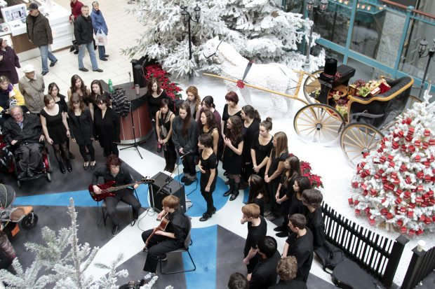 Victoria High School choir sings during the launch of the annual Spirit of Giving campaign to benefit the Mustard Seed Food Bank at the Bay Center. (Dec. 2011)