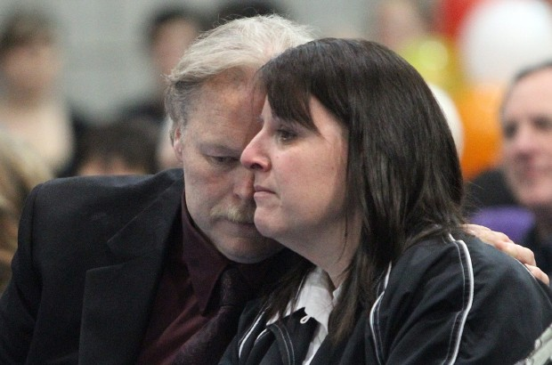 Ken and Laurie Noble sit and listen to family and friends during the memorial for their son, Tyler, at the Shawnigan Lake Community Centre on Sunday, Dec. 4, 2011.