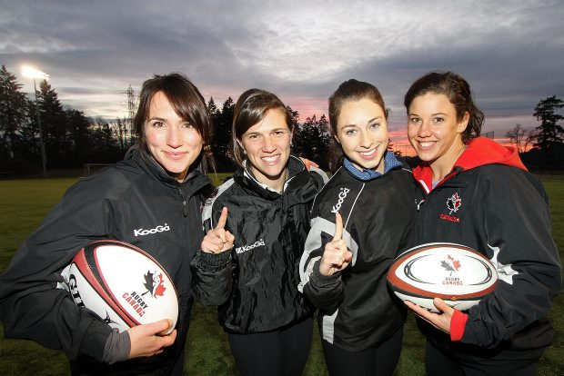 Rugby players, from left, Barbara Mervin, Julianne Zussman, Brittany Waters and Jessica Dovanne of the Canadian national team, get together for a workout Tuesday at the Pacific Institute for Sport Excellence in Saanich. They're on top of the world after a stunning championship victory at Dubai in the first-ever International Rugby Board-sanctioned women's sevens tournament. The sport will make its Olympic debut at Rio in 2016.