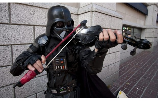 Darth Fiddler, one of Victoria's most popular buskers, plays downtown.