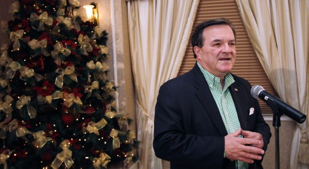 Federal Finance Minister Jim Flaherty addresses media at the Hotel Grand Pacific in Victoria on Sunday, Dec. 18, 2011.