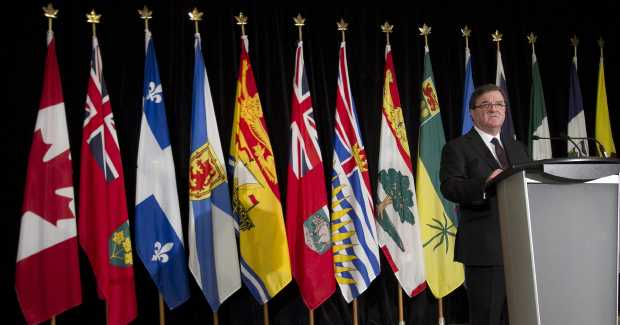 Federal Finance Minister Jim Flaherty addresses the media at the Hotel Grand Pacific yesterday, announcing reductions in the federal funding formula for health care.