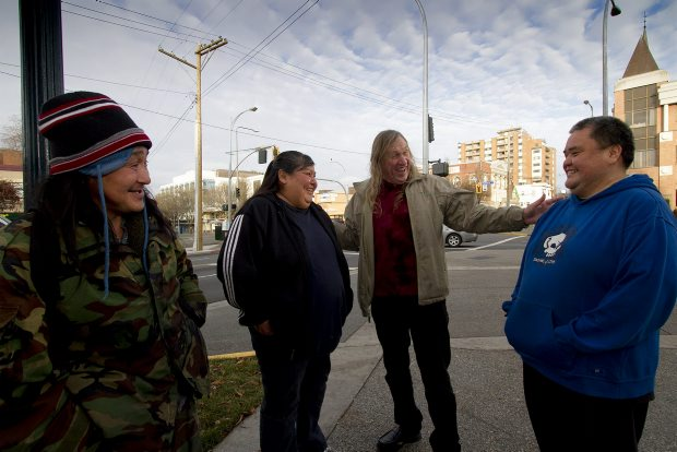 Rev. Al Tysick (second from right) on the streets of Victoria sharing a joke with, from left, Mits Turqtuq, Lorraine Andrew and Gerald Amos .