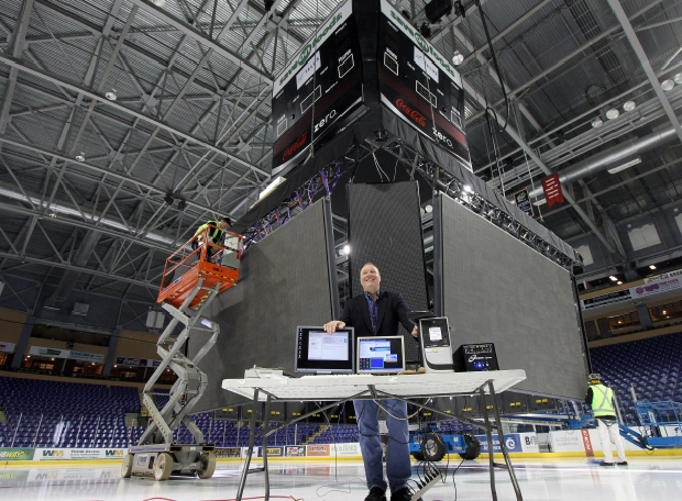 Dave Dakers, president of RG Sports & Entertainment and the Royals stands in front of the main video boards that were being installed as part of a new system at Save-On-Foods Memorial Centre on Dec. 30, 2011