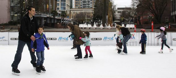 Adults and children skate on the seasonal rink at Centennial Square last week.