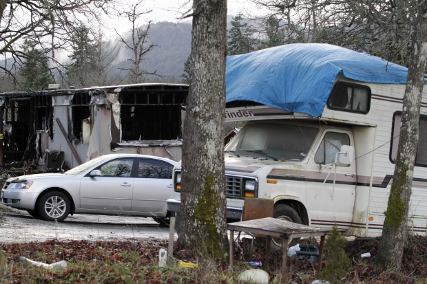 A blackened shell is all that remains of a mobile home after a fire on the Tsartlip First Nation reserve Dec. 29, 2011. The blaze claimed a 44-year-old man's life. The other seven residents were not in the home when the fire started.