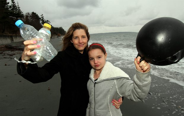 Beth Hayhurst and her daughter, Tatum, 10, with some of the debris they have found on the beach. (Jan. 2012)