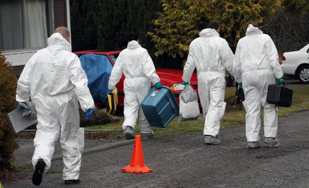 Members of the Vancouver Island Integrated Major Crime Unit, with assistance from Sooke RCMP conduct a homicide investigation at Park Village trailer park, at #2615 Otter Point Road in Sooke on January  9, 2012
