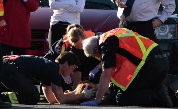 Paramedics attend to a pedestrian who was struck by a vehicle at Hillside Avenue and Cedar Hill Road Tuesday.