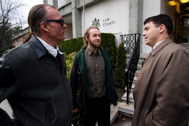 Ted Smith, left, Owen Smith and lawyer Kirk Tousaw share thoughts outside the Victoria courthouse Monday.