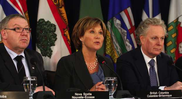 Nova Scotia Premier Darrell Dexter, B.C. Premier Christy Clark and Quebec Premier Jean Charest address the media during the Council of the Federation meeting at the Laurel Point Inn in Victoria on Jan. 17, 2012.