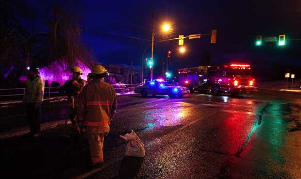 Emergecy crews shut down Carey Road after a Jeep hit a power pole on icy roads in Victoria on Tuesday Jan. 17, 2012.