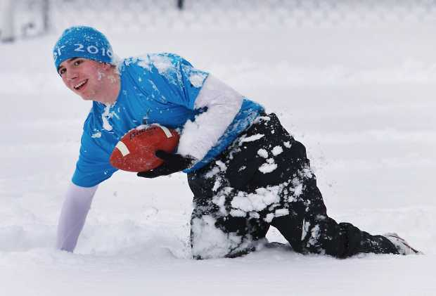Claremont High School student Tyler Swinton plays football at Lochside Park on Wednesday Jan. 18, 2012.