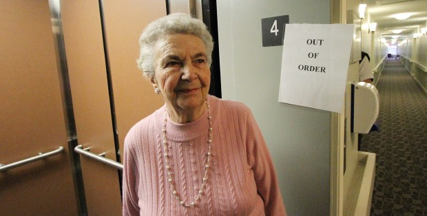 Mae Boyd outside the elevator at Langford's Alexander Mackie independent living residence, where she and five others were trapped for an hour and a half on Sunday, Jan. 22, 2012.