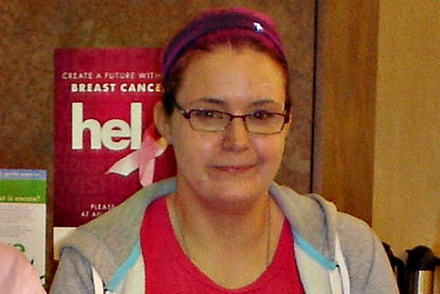 Police have released a picture of a woman who allegedly stole money by pretending to be a volunteer at a breast cancer fundraiser.