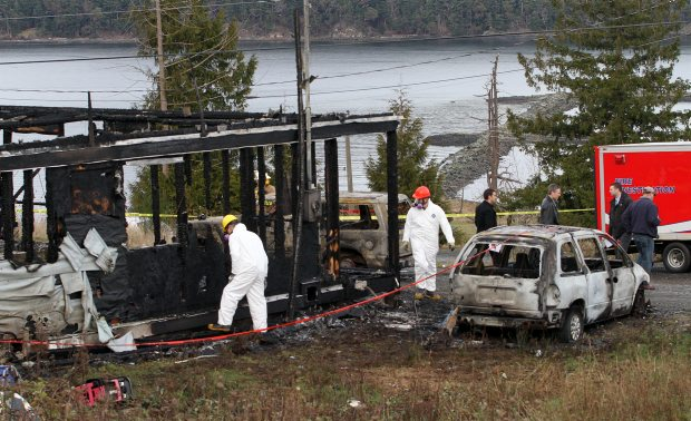 RCMP at the scene of the fire at the Snaw'Naw'As, Nanoose First Nations, reserve.
