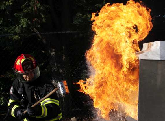 A fireball erupts after training officer Heath A. Bevan poured water on a grease fire.