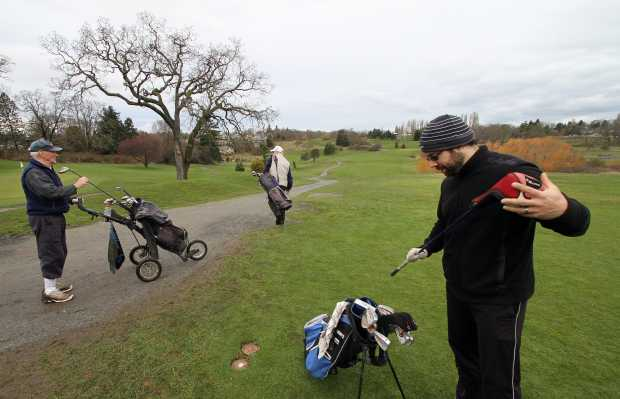Jack Trueman, Bill Hosie and Derek Johnston finish teeing off at the 16th hole at Cedar Hill Golf Course on Monday. The municipality of Saanich is wrestling with ways to cut its losses on the course, one of the few low-cost courses in the capital region.