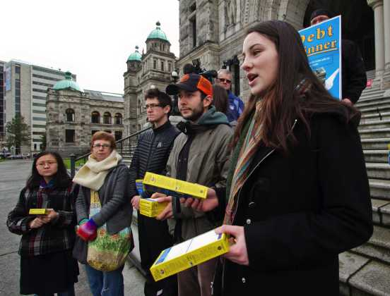 Camosun College student Madeline Keller-MacLeod speaks at Tuesday's rally in front of the B.C. legislature to promote today's day of action.