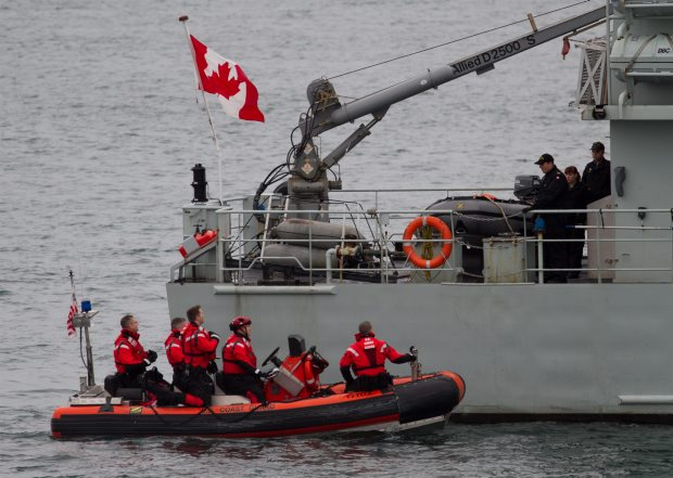 Wahoo crew members, posing as RCMP officers, line up against patrol craft training vessel Renard, which was posing as a smuggling ship during Thursday's drill.