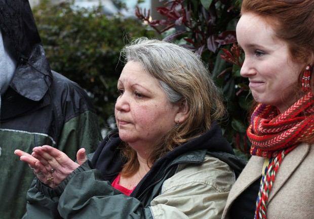 Cindy Simpson, left, mother of Ariana Simpson, and Sinead Charbonneau reflect during a ceremony at the corner of Quadra Street and Pandora Avenue on Sunday, Feb. 12, 2012. Ariana, 20, was killed on Feb. 12, 2009, when she was pushed under a bus nearby. The ceremony was held as part of the fourth annual Stolen Sisters memorial march for missing and murdered indigenous women.