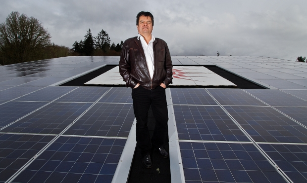 Chief Gordon Planes walks among banks of solar panels atop a building on the T'Sou-ke reserve in Sooke. Altogether, there are 400 solar panels in the ambitious three-year project that harnesses the sun in an effort to create a sustainable community.