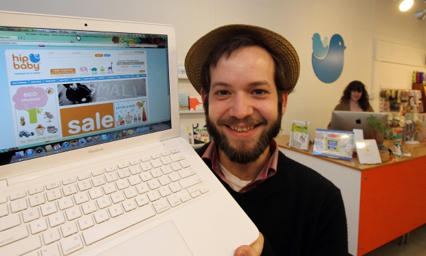 Liam McLachlan runs a service that provides free internet access service, sponsored by businesses. He has six locations, including at Hip Baby, and plans to expand.