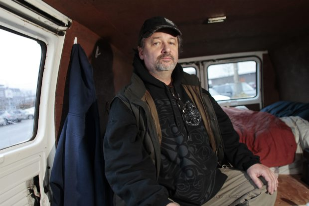 Richard Leblanc makes himself comfortable in the van that has become his temporary home.