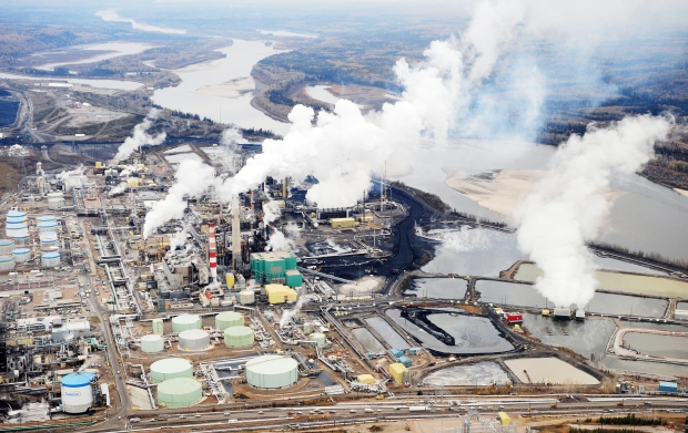 Two Canadian climate change scientists say all forms of fossil fuels, including the oilsands (below) and coal, must be regulated for the world to avoid dangerous global warming.