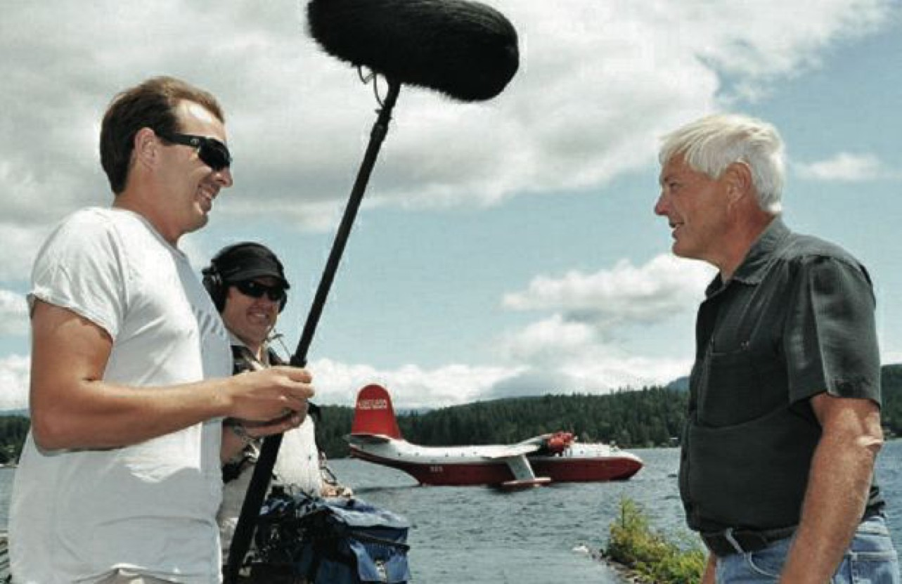 With the mighty Mars behing them, Discovery Channel director Michael Davidson speaks with Coulsonês chief operating officer Jim Messer on the afternoon of July 7, 2011, while the crew is filming  at the Coulson's bomber base on Sproat Lake.