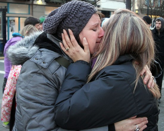 Tyler's Noble's mother, Laurie Noble, left, gets a hug from supporter Shannon Sartori during the vigil for Tyler outside the McDonald's restaurant on Douglas Street on Sunday, February 26, 2012.