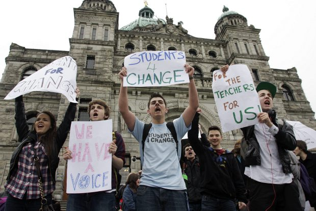 Students demonstrate against Bill 22 and in favour of teachers at the legislature in Victoria on Friday.