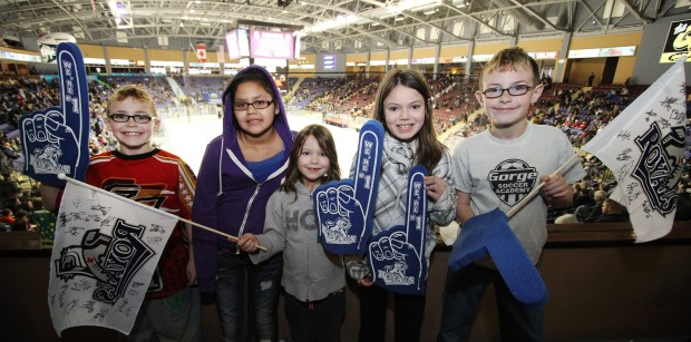 From left, Jaxon Stapley, 8, Kayla James, 11, Emily Skaalrud, 6, Kendra Skaalrud, 9, and Tyson Stapley, 11, of the Victoria Boys and Girls Club, take a timeout from the action at the Save-on-Foods Centre to pose for this photo on Sunday, March  4, 2012.
