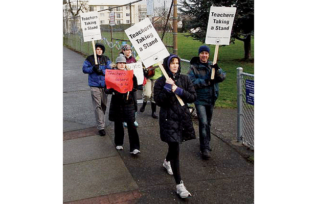 Teachers demonstrate in front of Willows Elementary on Monday