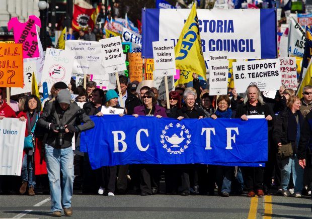 Demonstrators march down Government Street on Tuesday March 6, 2012, to a B.C. Teachers Federation and B.C. Federation of Labour rally at the B.C. legislature.