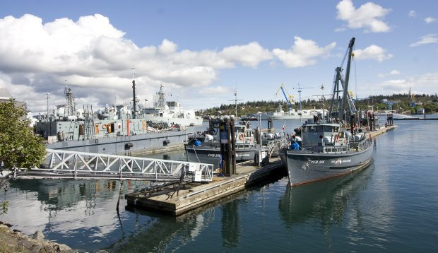 The two Blue Boats in the foreground have been used as ferries to transport people to and from CFB Esquimalt, but the base is planning to end that service at the end of April.