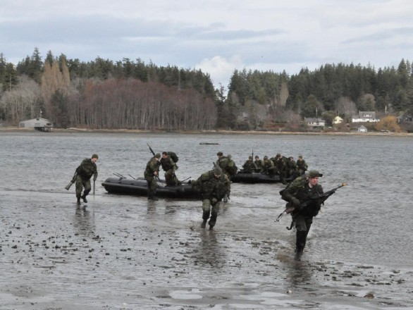 Soldiers from 41 Canadian Brigade Group practise beach landings at HMCS Quadra, near CFB Comox, on Saturday afternoon, during Exercise Highland Orca. Exercise Highland Orca, which took place in Comox from March 9-11, 2012, was a unique opportunity for army and navy reservists from Calgary to train in coastal areas as they practiced methods and means of attacking from the sea to accomplish a beach landing.