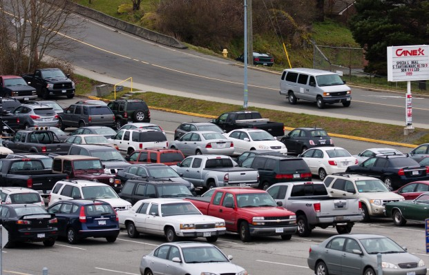 A CFB Esquimalt parking lot is filled with vehicles.